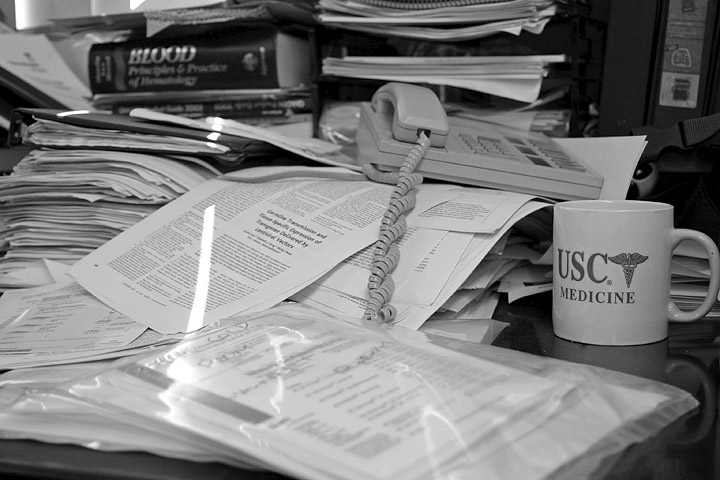 Papers strewn across office in un organised mess